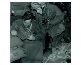 Last minute map check before   training jump from a Douglas Dakota.
