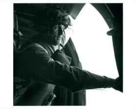 The first of a parachute stick waits for the green light before jumping from the aircraft.