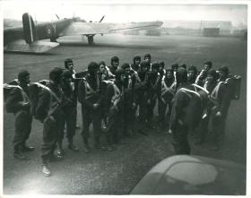 Equipped troops are briefed prior to training jumps from a Whitley aircraft.