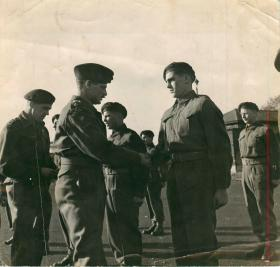 Men receive their parachute wings in a presentation on successful completion of their jump training.