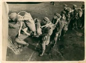 Recruits emplaning prior to a training jump at Ringway. Note number two is carrying his parachute container.