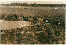 Posed photo of troops practising rallying on the drop zone.