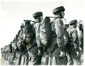 Members of an early parachute course assemble prior to an aircraft descent.