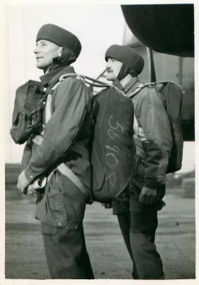 Posed shot of two equiped paratroopers ready to emplane.