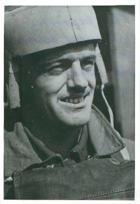Early paratrooper wearing a specially constructed helmet.