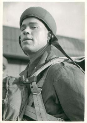 Early paratrooper looks at the camera prior to a training exercise.