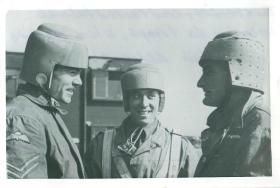 Three paratroopers wearing early experimental head protection.