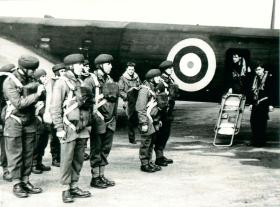 Early shot of men emplaning prior to parachute descent.