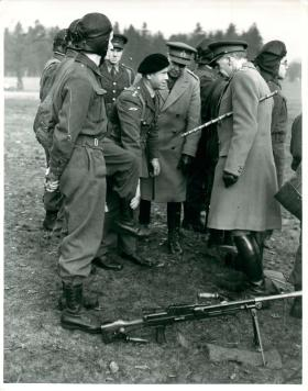 General Sir John Dill inspects the boots worn by paratroopers.