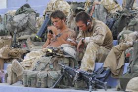 Soldiers from 3 PARA await their next duties, Kandahar Stadium, Afghanistan, June 2008.