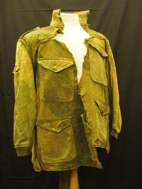 The early pattern smock of CSM Warcup damaged in 1944 on Op Varsity, from the Airborne Assault Museum Collection, Duxford.
