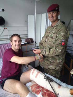 Spr Daniel Watson being awarded his wings in hospital, undated.