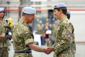 HRH Prince of Wales presents a trophy to Major Beattie, Wattisham, 9 May 2013.