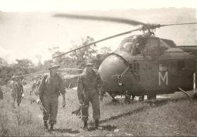 Members of 2 PARA move off from a landing zone, Borneo, undated.
