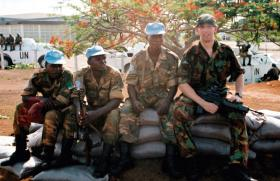 L/Cpl 'Lefty' Wright with members of the Zambian Armed Forces, Sierra Leone, May 2000.