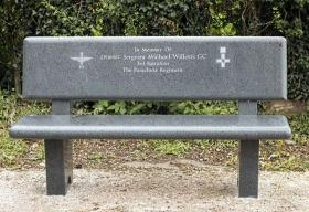 Memorial seat for Sgt M Willetts GC, St Mary's Church, Blidworth in Nottinghamshire, 2015.