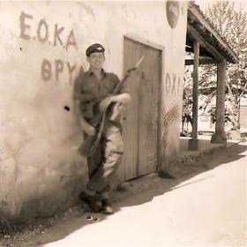 Pte Roy Coles B Coy 3 PARA standing next to EOKA Graffiti Cyprus 1956