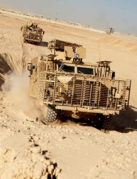 A Wolf Hound vehicle climbing an incline with 16 Air Assault, Afghanistan, 2010