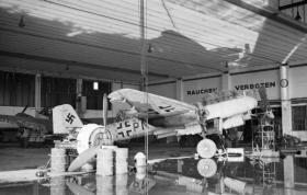 A captured Junkers Ju 88 aircraft in a hangar at Wunstorf airfield, April 1945.