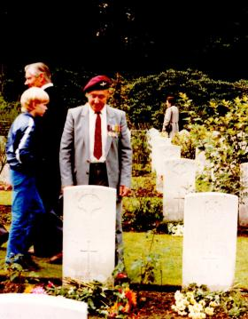 Peter Wyke at the grave of Jimmy Frost, Oosterbeek, 1984