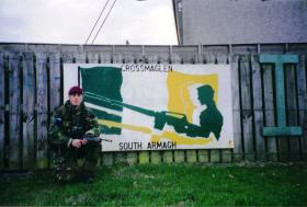 Mark Magreehan beside some sectarian graffiti, Crossmaglen, South Armagh, Northern Ireland
