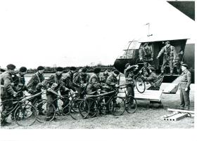 Airborne troops load bikes into a glider for Normandy landing.