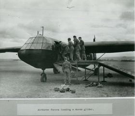 Airborne soldiers load a Horsa glider.