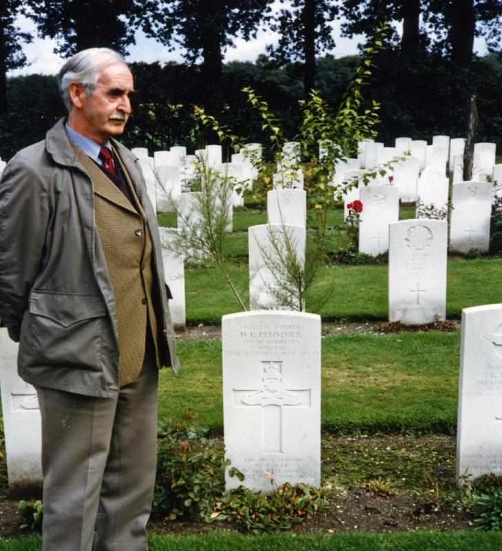 Ex Member of C troop and comrade of David Plummer stands by Grave