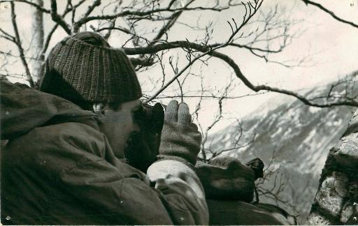 Private Hurst of 2nd Independent Parachute Brigade looks through binoculars near Cassino.