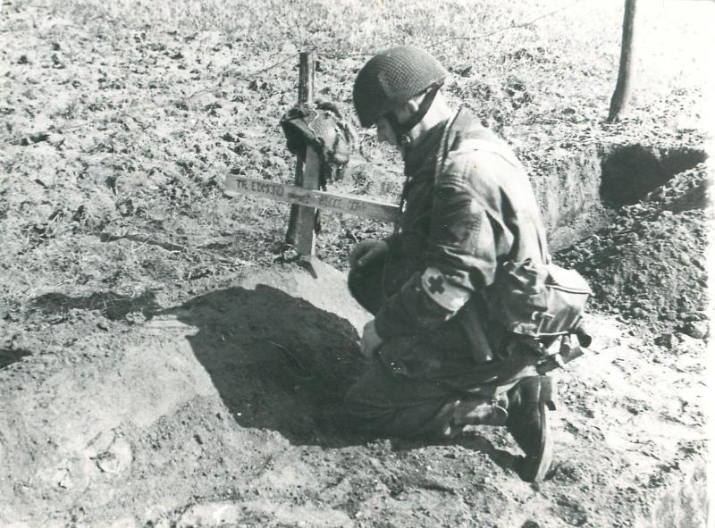 Corporal Mills pays his repect to the grave of Trooper Edmond.