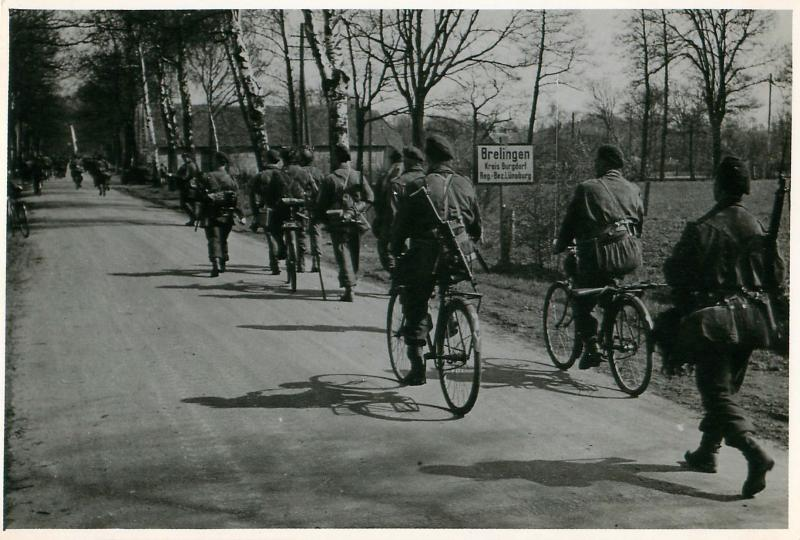 Members of 5th Parachute Brigade walk and cycle to Brelingen.
