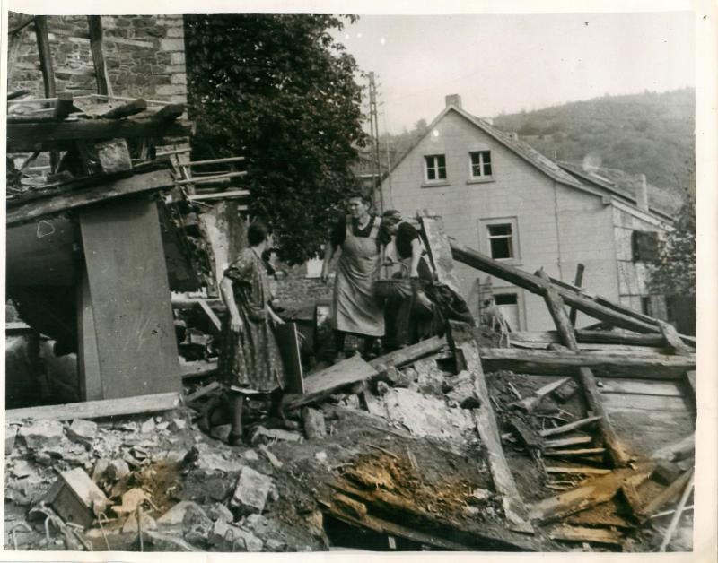 German women search the wreckage of their homes shelled by the Americans.