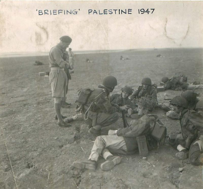 Men being briefed for an exercise in Palestine, 1947.