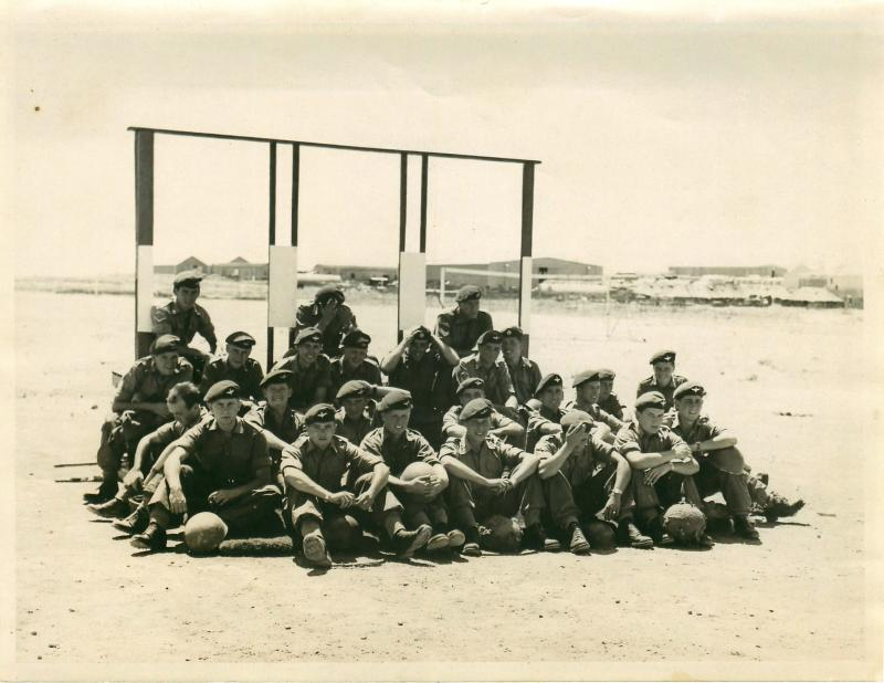 Group of troops await briefing during synthetic training.
