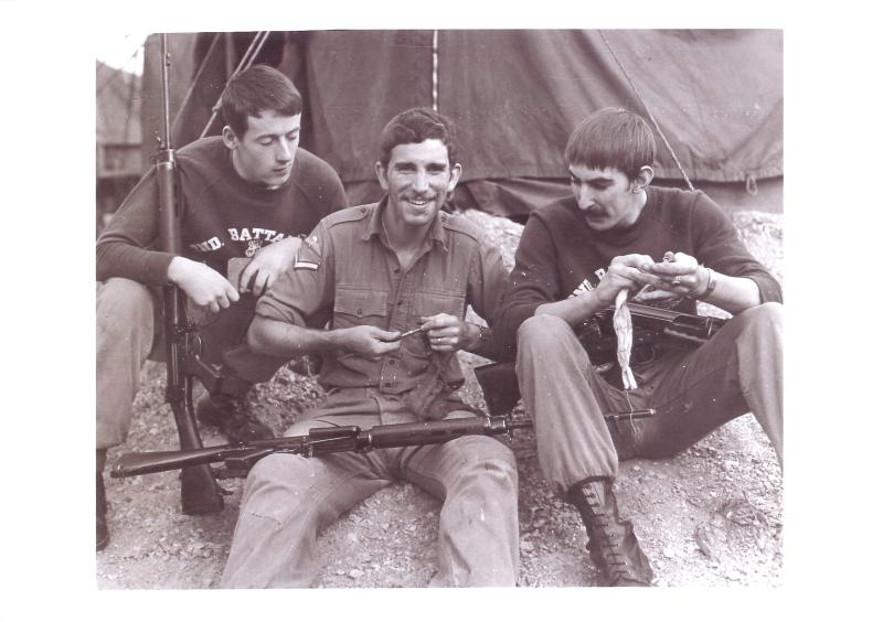 Corporal Stephen Prior and comrades clean their rifles.