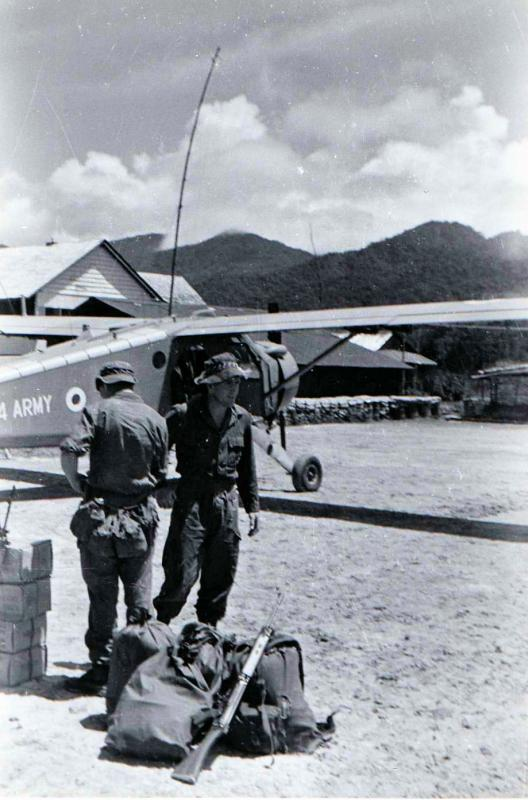 Brunei, waiting for helicopter into Ulu, 1965