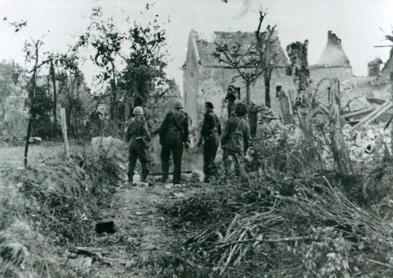 Members of 6th Airborne Division outside Breville church.