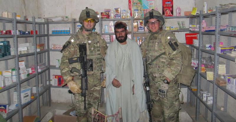 Doctors from 16 Medical Regiment, RAMC, with a local pharmacist, Afghanistan, 2011