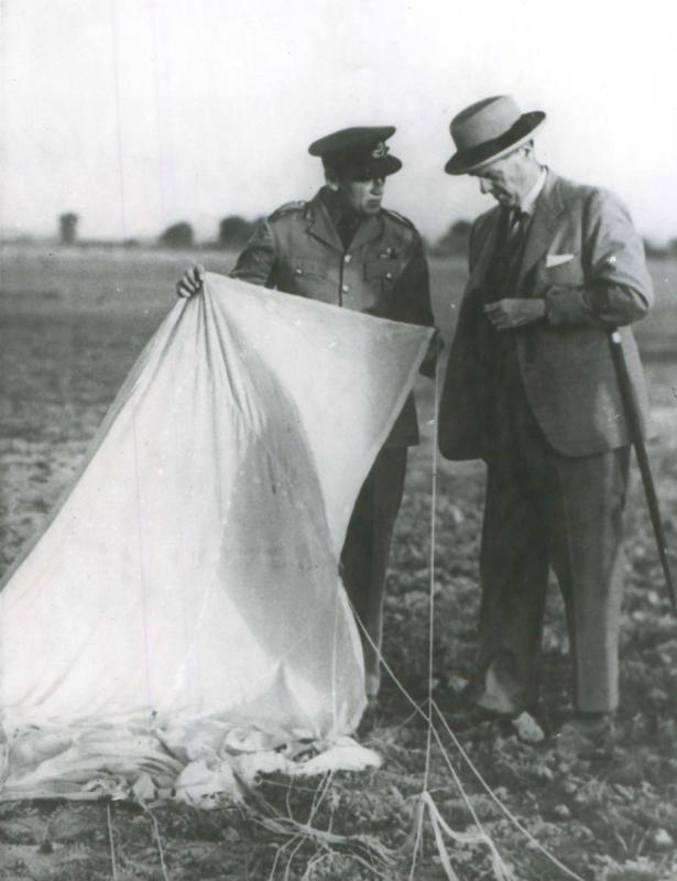 The Viceroy of India Lord Linlithgow inspects parachute with Sqn Ldr Brereton at New Delhi, 1941.