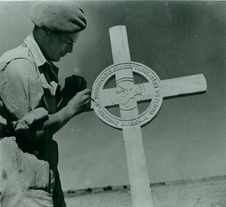 Soldier attends to the field grave og Corporal Page.