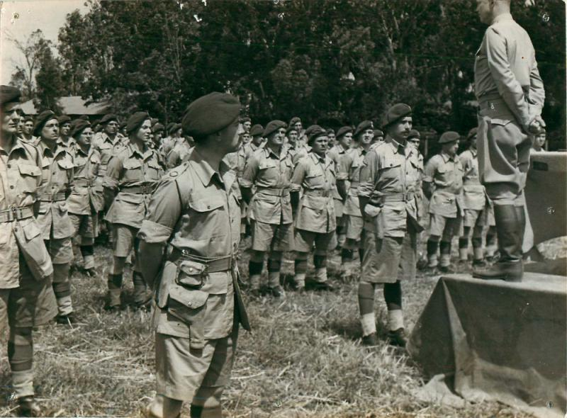 General Eisenhower addresses 1st Parachute Brigade from a raised platform.
