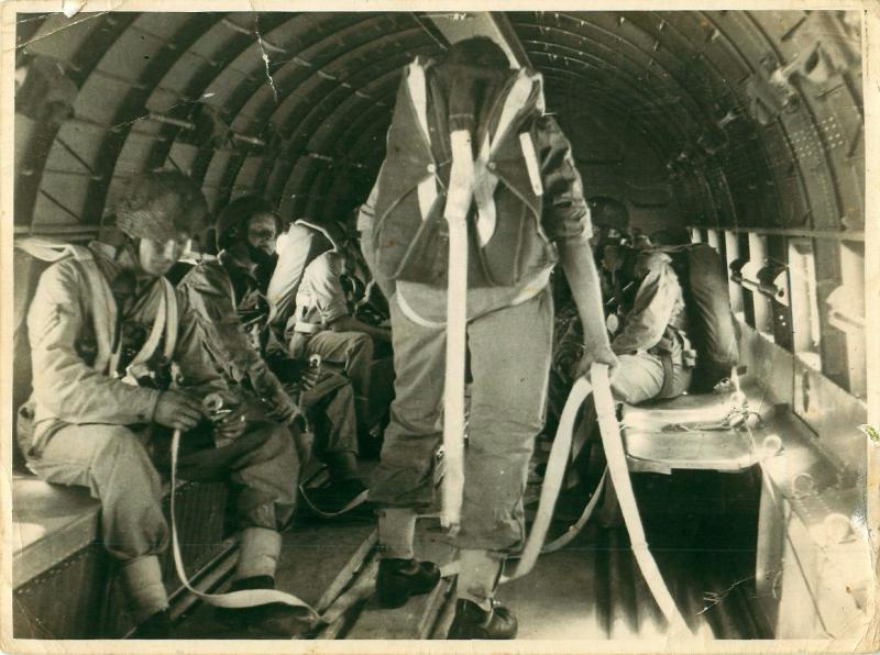 Paratroopers training in a Douglas Dakota aircraft. The strop is attached to the floor of the aircraft.