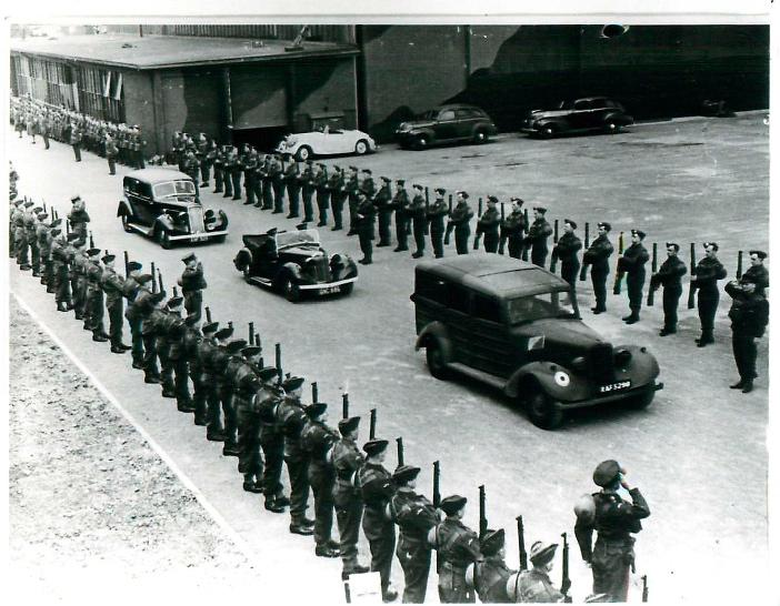 Winston Churchill's motorcade passes lines of soldiers on his visit to Ringway, April 1941.